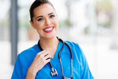healthcare portrait: pretty female healthcare worker closeup portrait in office Stock Photo