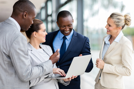 african american woman business: modern business group using laptop computer in office Stock Photo
