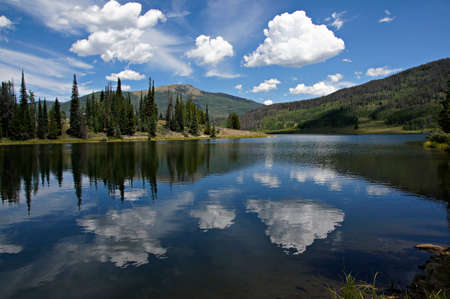 colorado rockies: In this scene, afternoon clouds reflect from Pearl Lake s deep blue waters    Steamboat and Pearl Lakes State Parks are located in Clark County near the north west quadrant of Colorado just south of Wyoming