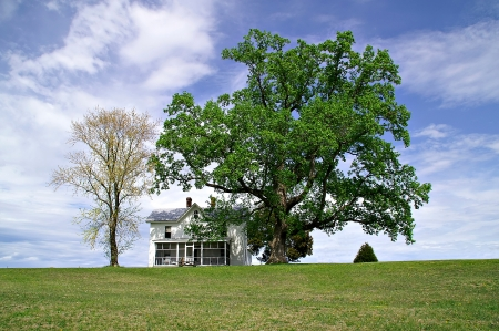 Lottsburg, Virginia, USA - April 16, 2006 - White House on a hill in rural setting during springtime