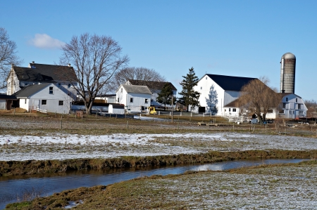 Lancaster, Pennsylvania, USA - Feb 09, 2013 - These farm houses sit behind an irrigation ditch in Pennsylvanias Amish community.