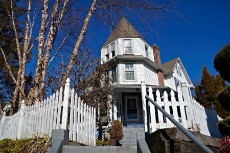 Philadelphia, PA, USA - Feb 10, 2013 - A white picket fence surrounds this Pennsylvania Victorian Era House. Editorial
