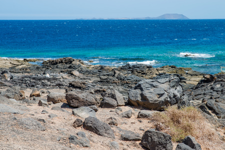 Lava stones on shore of Playa Blanca, Lanzarote