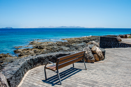 Bench on a promenade in Playa Blanca, Lanzarote Stock Photo