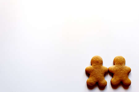 Two gingerbread men on a white background