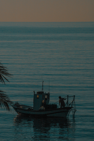 Traditional fishing boat in the Mediterranean sea Stock Photo