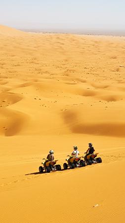 Pollution in the desert, ATV parked on the sand in the desert.