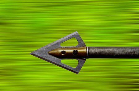 An archers arrow flying through the air.