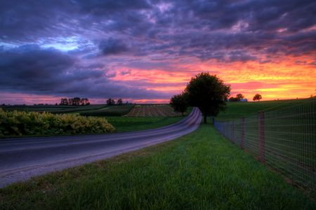 Beautiful sunset on a lonely country road in Berks County Pennsylvania.