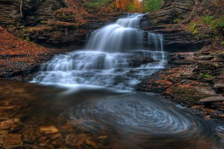 Onondaga Falls, Ricketts Glen State Park in Autumn with water swirl in plunge pool.
