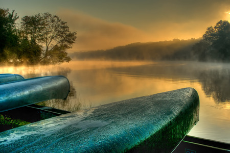 Canoes by the lakeside. Hopewell Lake, French Creek State Park, Pennsylvania.