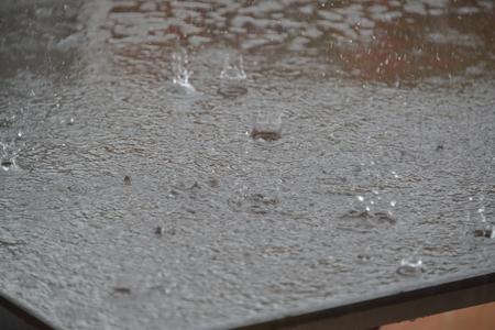 thundershower: Rain on the Table Stock Photo