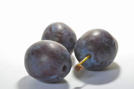 pome: three plums