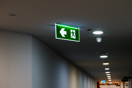 Exit sign along the way in the office Standard-Bild