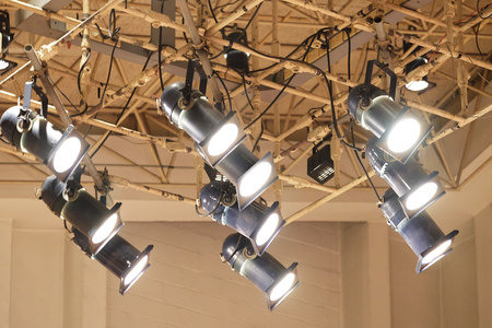Spotlights installed on structured ceiling shining the light