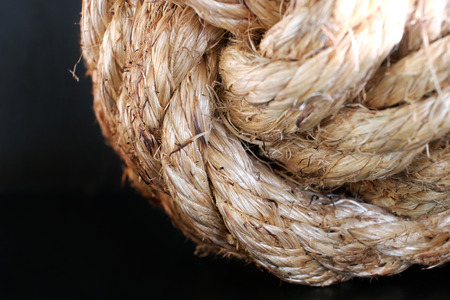 Closeup of hemp rope on black background Stock Photo