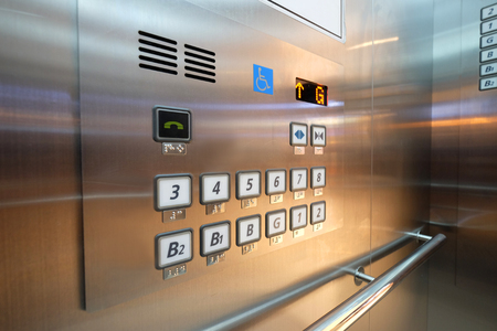 Buttons in elevator with Braille code for blind people