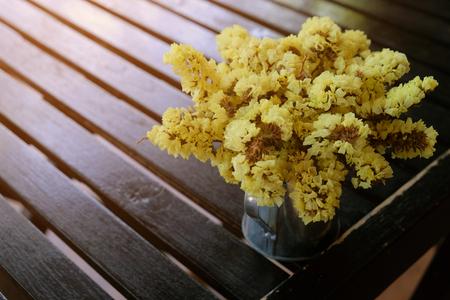 Light yellow statice flower in black flowerpot on wood table stock light yellow statice flower in black flowerpot on wood table stock photo 102432026 mightylinksfo