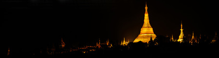 Panorama of Shwedagon pagoda at night in tele mode Stock Photo