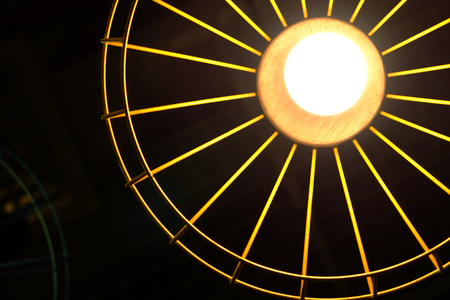 Bottom view of light bulb in the yellow grille hanging lamp