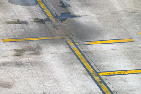 Yellow line painting on taxiway to guide pilot of airplane to drive at the airport