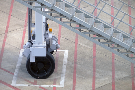 Closeup of wheel and stairway of air bridge, parking at the designed position at airport