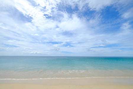 Calm and clear sea view of turquoise water on cloudy blue sky day