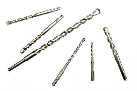 Set of twist drill bits in different size on white background