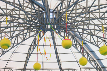 Top of the inside dome, structured by steel, with balls and rings hanging Foto de archivo