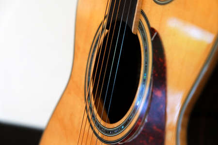 Closeup guitar strings at the sound hole