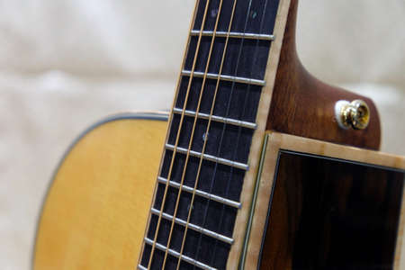 Closeup of strings at the neck of guitar instrument