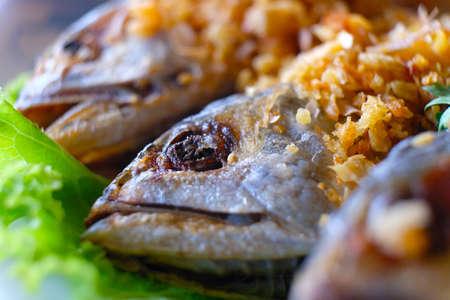 Closeup head part of fried Short Mackerel fish