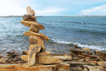 Tower of stone or rock at the sea beach