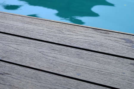 Edge of wooden walkway closed to turquoise color lake Foto de archivo