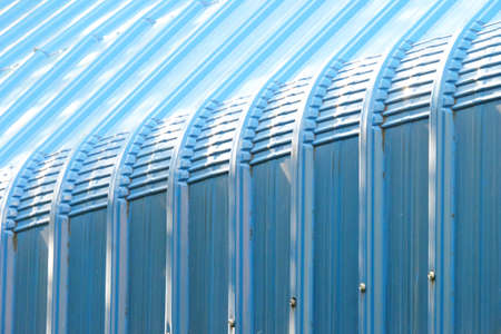 Closeup perspective view of blue structured roof with sunlight and shadow