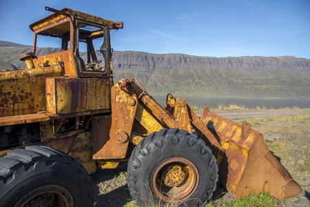 An abandoned loader in the eastfjords of Iceland. Imagens - 118120321
