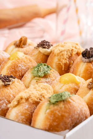 A bombolone or bomboloni is an Italian filled doughnut and is eaten as a snack food and dessert. This Bomboloni has many flavors like strawberry, chocolate, blueberry, etc. Reklamní fotografie