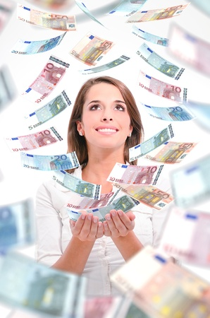 on the dole: woman with money Stock Photo