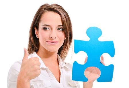 woman holding a blue puzzle piece
