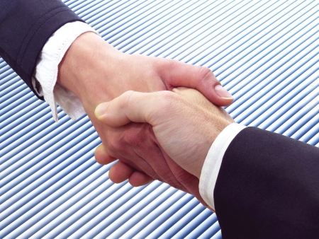 Conceptual photography of a business handshake Stock Photo - 16573692
