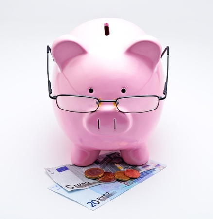 Piggy bank with glasses on Euros illustrating concepts of money
