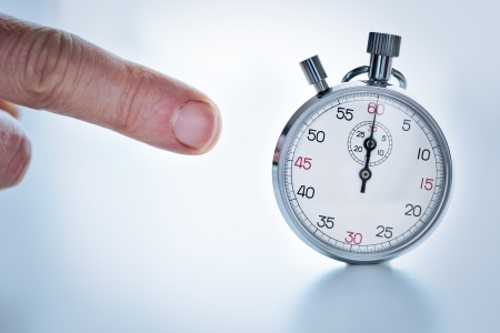 chronograph: Photograph showing a finger pointing a stopwatch