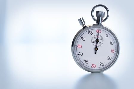 Photograph showing Stopwatch isolated on background blue tone