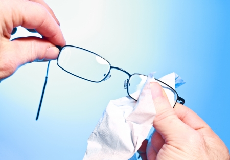 Closeup photograph illustrating cleaning glasses; Stock Photo