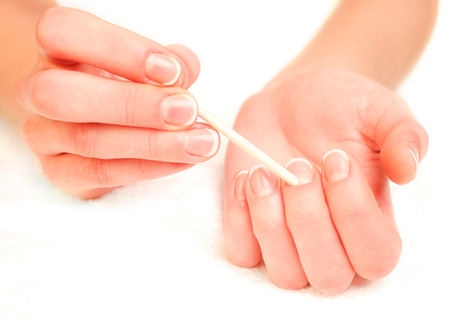 Photography of a woman pushing cuticles