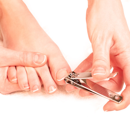 Photography closeup of a woman cutting toenails Archivio Fotografico