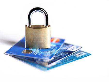 electronic transaction: photograph of a lock placed on credit cards illustrating the secure payment Stock Photo