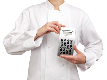 Photograph of a bust of a cooker holding a calculator Stock Photo