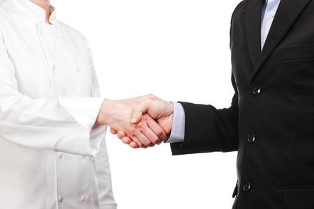 Photograph of a handshake between a cook and a businessman Stock Photo