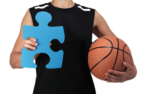 photography of a basketball player holding a puzzle piece